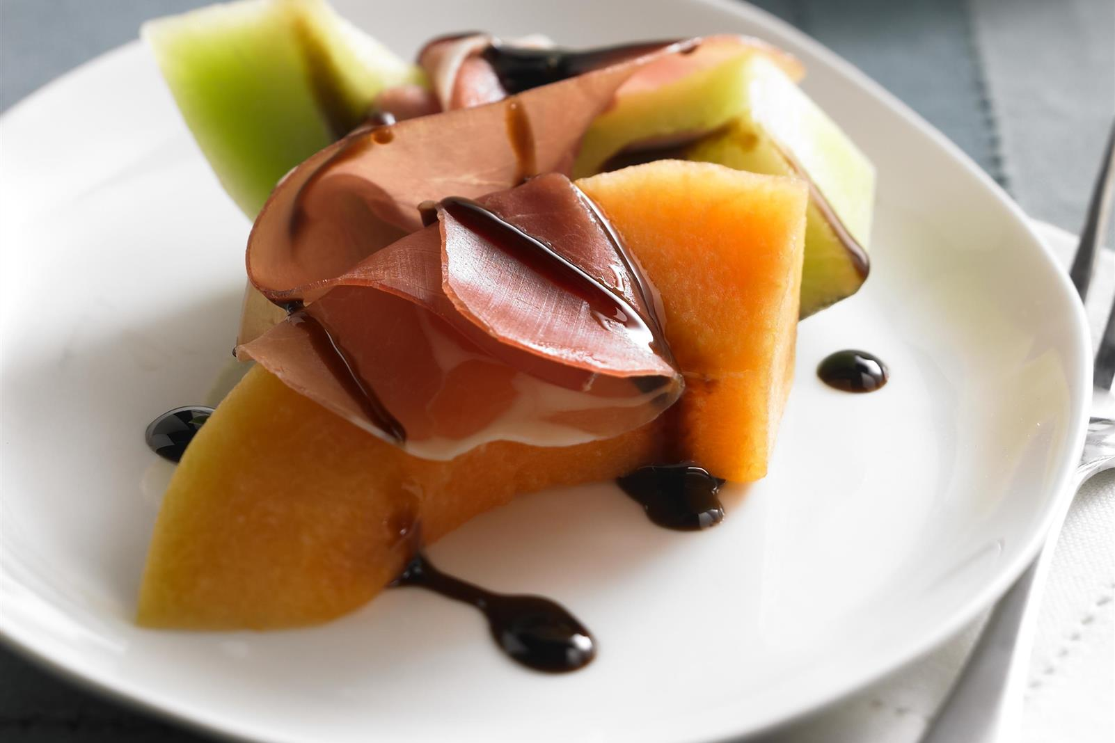 Melon and Prosciutto with Ruby Cranberry Drizzle